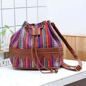 Gorgeous multi color canvas cross body satchel. 8b5379e92d651